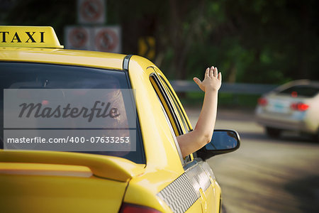 people travelling. Female passenger in taxi with arm outside of car window waving hand. Concept of freedom Stock Photo - Budget Royalty-Free, Image code: 400-07633253