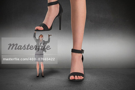 Composite image of female feet in black sandals standing on businesswoman Stock Photo - Budget Royalty-Free, Image code: 400-07665422