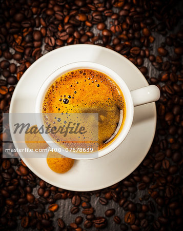 Espresso cup in coffee beans - top view Stock Photo - Budget Royalty-Free, Image code: 400-07678639