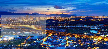 Famed skyline of Hong Kong  Yuen Long downtown sunset Stock Photo - Budget Royalty-Free, Image code: 400-07716711