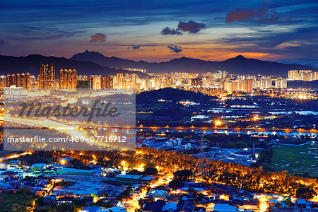 Famed skyline of Hong Kong  Yuen Long downtown sunset Stock Photo - Budget Royalty-Free, Image code: 400-07716712