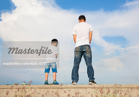 father and son standing on a stone platform and pee together Stock Photo - Budget Royalty-Free, Image code: 400-07720007
