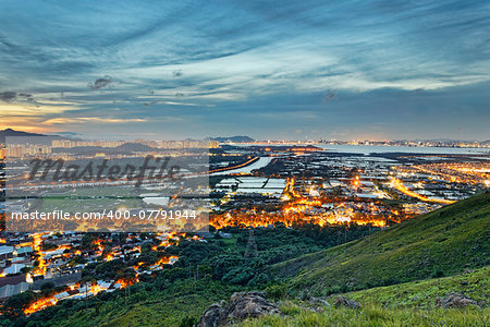 Famed skyline of Hong Kong Yuen Long downtown sunset Stock Photo - Budget Royalty-Free, Image code: 400-07791944