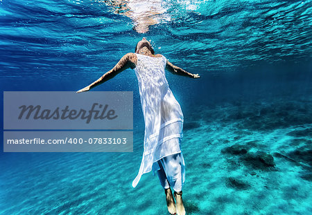 Young female swimming underwater, enjoying nice refreshing water, wearing long dress, summer vacation and travel concept Stock Photo - Budget Royalty-Free, Image code: 400-07833103