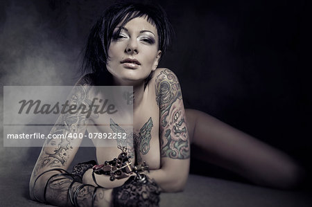 Beautiful woman with many tattoos posing indoors Stock Photo - Budget Royalty-Free, Image code: 400-07892252