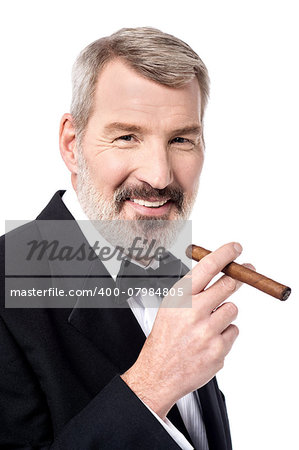 Senior businessman posing with cigar Stock Photo - Budget Royalty-Free, Image code: 400-07984805
