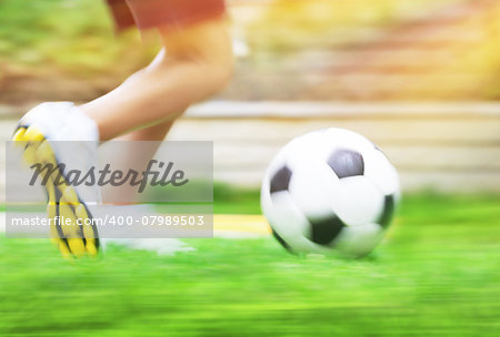 Football game slow motion, body part, sportive teen boy runs for ball, soccerl championship, active teens lifestyle, recreation and hobby Stock Photo - Budget Royalty-Free, Image code: 400-07989503