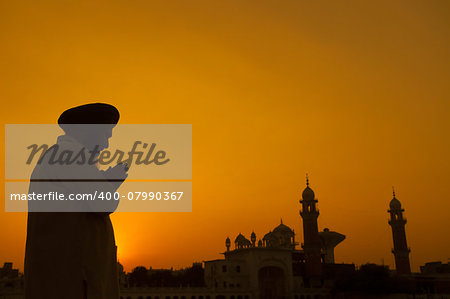Silhouette of Sikh prayer at temple, Amritsar, India Stock Photo - Budget Royalty-Free, Image code: 400-07990367