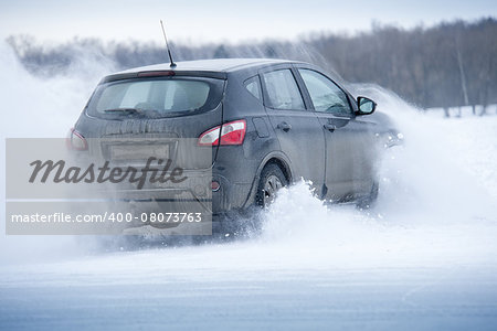 Car drift spray snow Stock Photo - Budget Royalty-Free, Image code: 400-08073763
