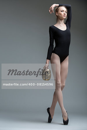 Portrait of the young graceful ballerina with a bronze metal mask in hand Stock Photo - Budget Royalty-Free, Image code: 400-08154596