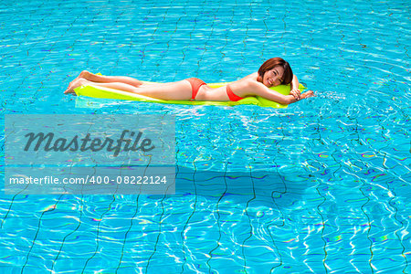 Young woman relaxing in swimming pool Stock Photo - Budget Royalty-Free, Image code: 400-08222124