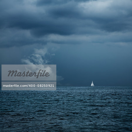 Boat Sailing in Center of Storm Formation. Dramatic Background. Danger in Sea Concept. Toned Photo with Copy Space. Stock Photo - Budget Royalty-Free, Image code: 400-08250921