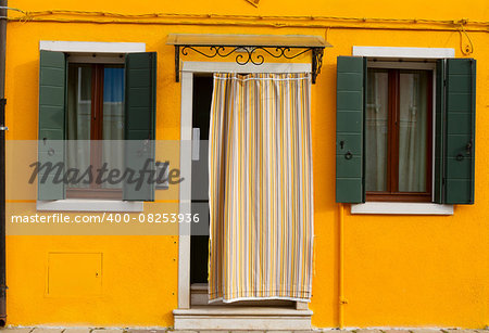 bright yellow typical house facade of Burano island, Venice, Italy Stock Photo - Budget Royalty-Free, Image code: 400-08253936
