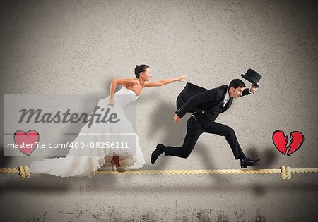 Husband escapes from wife on a rope Stock Photo - Budget Royalty-Free, Image code: 400-08256211