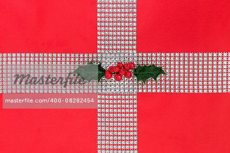 Christmas diamond bling and holly gift wrapping over red paper background. Stock Photo - Budget Royalty-Free, Image code: 400-08282454