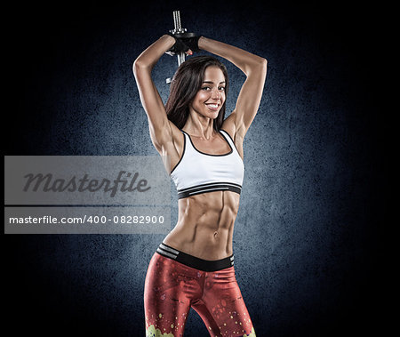 young beautiful girl with a sports figure doing exercises with dumbbells Stock Photo - Budget Royalty-Free, Image code: 400-08282900