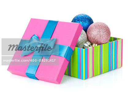Christmas colorful decor in gift box. Isolated on white background Stock Photo - Budget Royalty-Free, Image code: 400-08291417