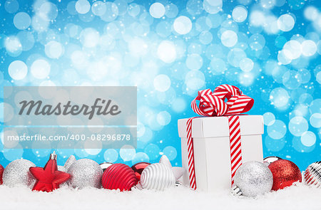 Christmas background with baubles, gift box and bokeh copy space Stock Photo - Budget Royalty-Free, Image code: 400-08296878