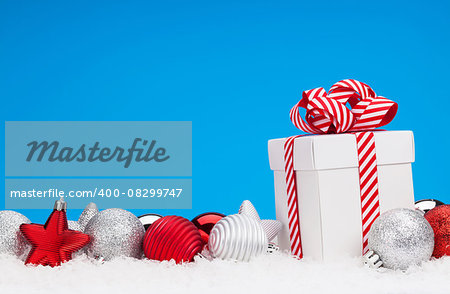 Christmas background with baubles, gift box and copy space Stock Photo - Budget Royalty-Free, Image code: 400-08299747