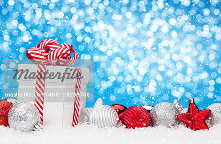 Christmas background with baubles, gift box and bokeh copy space Stock Photo - Budget Royalty-Free, Image code: 400-08299748