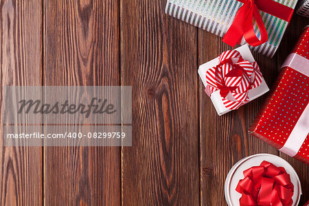 Christmas gift boxes on wooden table. Top view with copy space Stock Photo - Budget Royalty-Free, Image code: 400-08299759