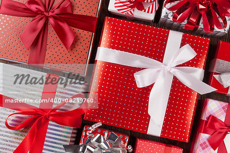 Christmas gift boxes on wooden table. Top view closeup Stock Photo - Budget Royalty-Free, Image code: 400-08299760