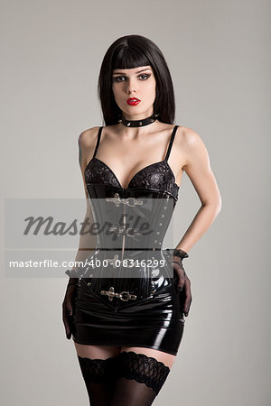 Young sexy woman in black fetish corset, mini skirt, and stockings Stock Photo - Budget Royalty-Free, Image code: 400-08316299