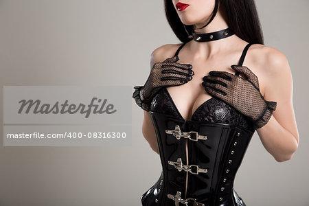 Close-up shot of sexy woman in black fetish corset and bra, studio shot Stock Photo - Budget Royalty-Free, Image code: 400-08316300