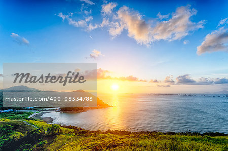 Village with beautiful sunset over hong kong coastline. View from the top of mountain Stock Photo - Budget Royalty-Free, Image code: 400-08334788