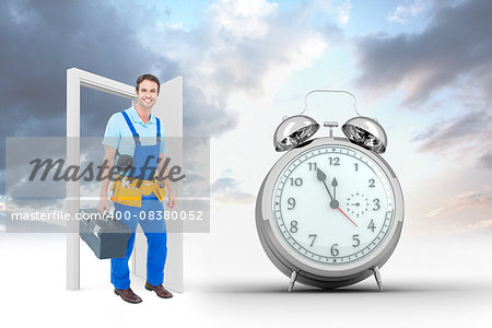 Happy plumber carrying tool box against alarm clock counting down to twelve Stock Photo - Budget Royalty-Free, Image code: 400-08380052