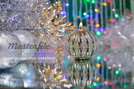 Christmas decorations with candle and silver balls on the mirror. Stock Photo - Budget Royalty-Free, Image code: 400-08427900