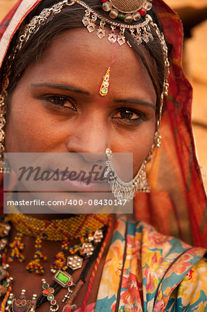 Close up portrait of traditional Indian woman in sari dress, India people. Stock Photo - Budget Royalty-Free, Image code: 400-08430147