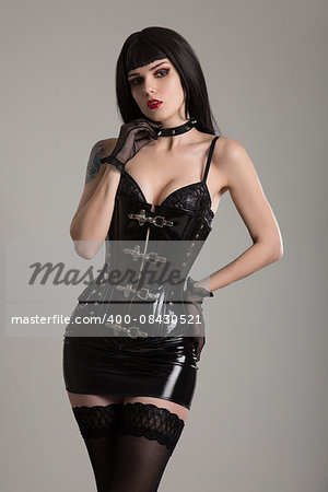 Dominatrix woman in black fetish corset, mini skirt, and stockings Stock Photo - Budget Royalty-Free, Image code: 400-08430521