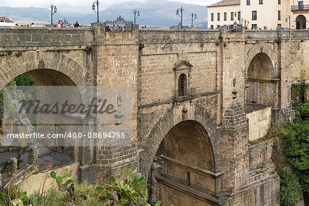 The Puente Nuevo (New Bridge) is largest bridges that span the 120-metre deep chasm that divides the city of Ronda, Spain. In was build in 1793 Stock Photo - Budget Royalty-Free, Image code: 400-08694755