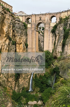 The Puente Nuevo (New Bridge) is largest bridges that span the 120-metre deep chasm that divides the city of Ronda, Spain. In was build in 1793 Stock Photo - Budget Royalty-Free, Image code: 400-08695646