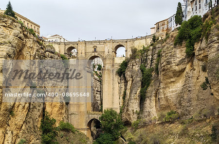 The Puente Nuevo (New Bridge) is largest bridges that span the 120-metre deep chasm that divides the city of Ronda, Spain. In was build in 1793 Stock Photo - Budget Royalty-Free, Image code: 400-08695648