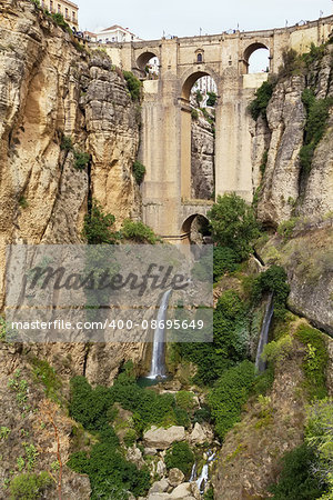 The Puente Nuevo (New Bridge) is largest bridges that span the 120-metre deep chasm that divides the city of Ronda, Spain. In was build in 1793 Stock Photo - Budget Royalty-Free, Image code: 400-08695649