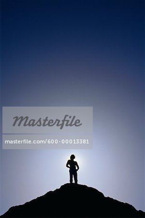Silhouette of Man Standing on Mountain Top