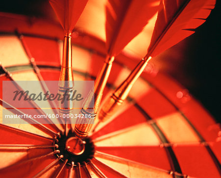 Close-Up of Darts in Bull's-Eye Of Dartboard Stock Photo - Premium Royalty-Free, Image code: 600-00034286