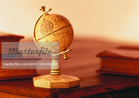 Globe on Stand on Desk with Books Stock Photo - Premium Royalty-Free, Image code: 600-00046594