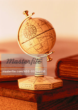 Globe on Stand on Desk with Books Stock Photo - Premium Royalty-Free, Image code: 600-00046595