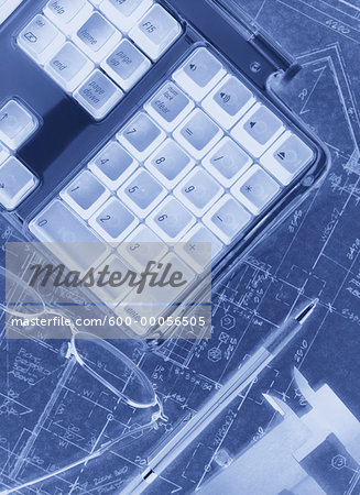 Computer Keyboard and Eyeglasses on Blueprints Stock Photo - Premium Royalty-Free, Image code: 600-00056505