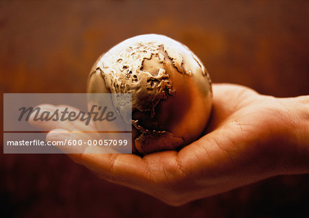 Globe in Palm of Hand North America Stock Photo - Premium Royalty-Free, Image code: 600-00057099