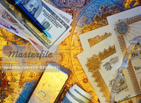 International Currency, Pen Stock Certificates and Gold Bar On Antique World Map Stock Photo - Premium Royalty-Free, Image code: 600-00065082