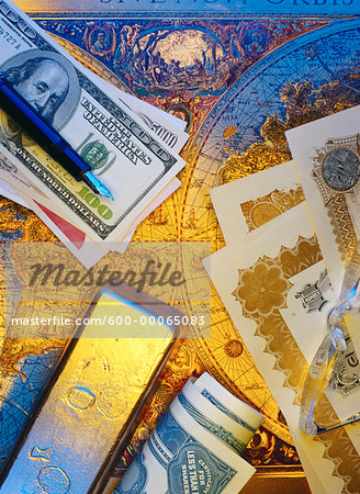 International Currency, Pen Stock Certificates and Gold Bar On Antique World Map Stock Photo - Premium Royalty-Free, Image code: 600-00065083