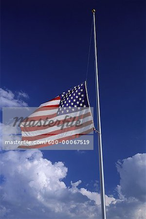 American Flag at Half Mast with Clouds in Sky Stock Photo - Premium Royalty-Free, Image code: 600-00067519
