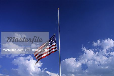 American Flag at Half Mast with Clouds in Sky Stock Photo - Premium Royalty-Free, Image code: 600-00067520