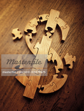 Wooden Jigsaw Puzzle Forming Dollar Sign Stock Photo - Premium Royalty-Free, Image code: 600-00070675