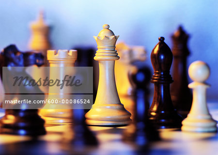 Close-Up of Chess Pieces on Board Stock Photo - Premium Royalty-Free, Image code: 600-00086524