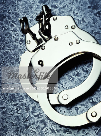 Handcuffs Stock Photo - Premium Royalty-Free, Image code: 600-00150356